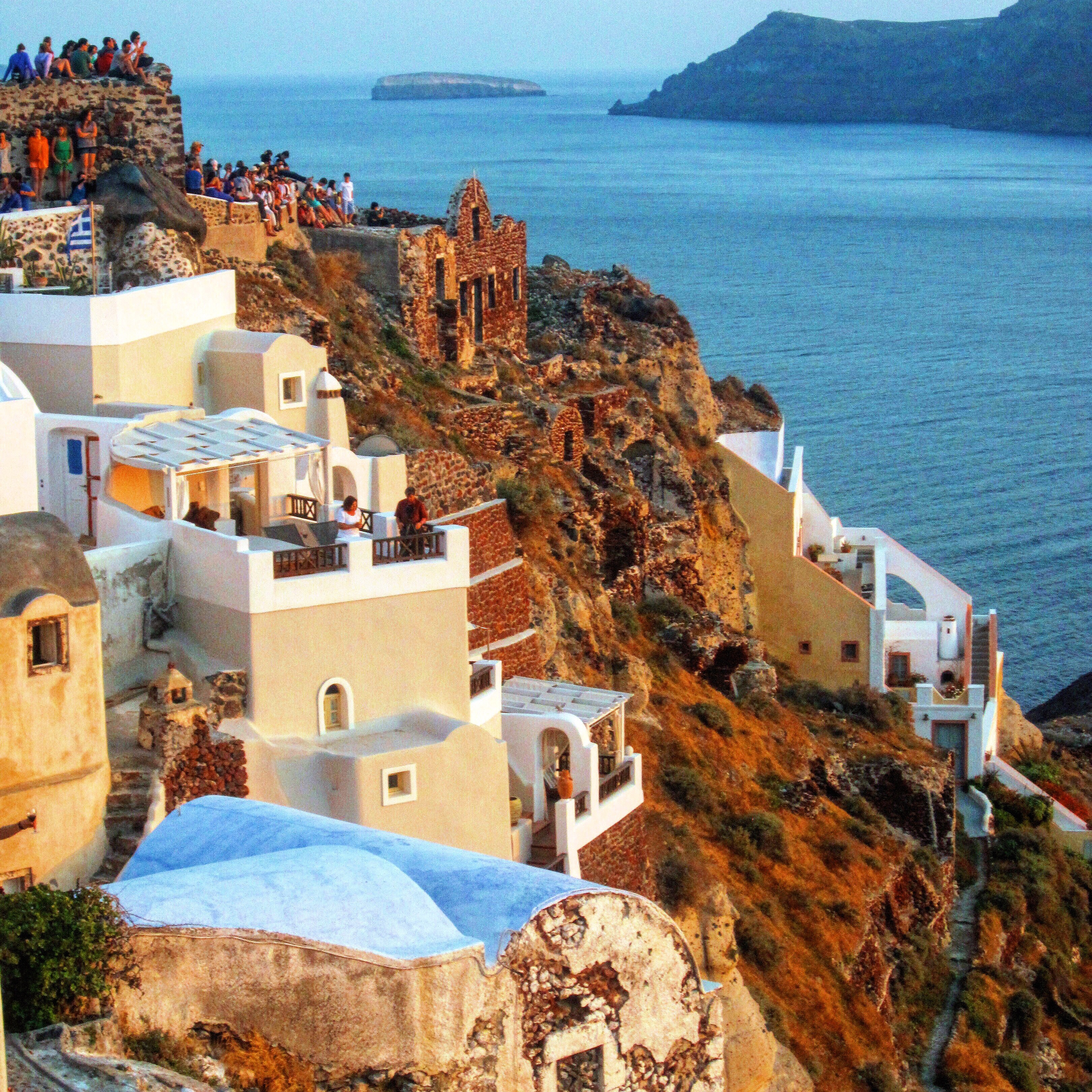 flights on Aegean Airlines to Greece to watch sunset in oia santorini