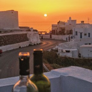 wine and sunset in Santorini, Greece
