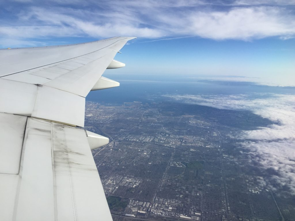 traveling with back pain on an airplane long flight